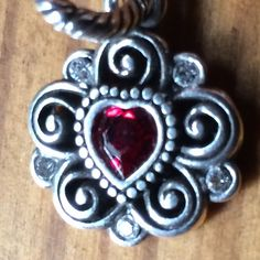 Brighton Heart Charm ♥️ Garnet (red) gem inside silver plated heart surrounded by scroll & gemstone details. Charm can be worn on bracelet or necklace. Perfect for a January birthday. Please ask if you have questions. Brighton Jewelry