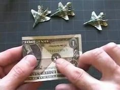 Origami airplane with dollar bill
