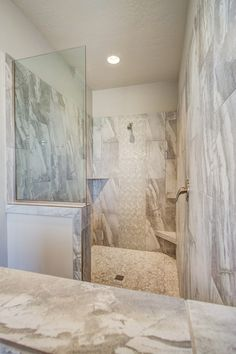 Contemporary Master Bathroom with Bali cloud pebble tile, High ceiling, Frameless Shower Screens By Dulles Glass and Mirror