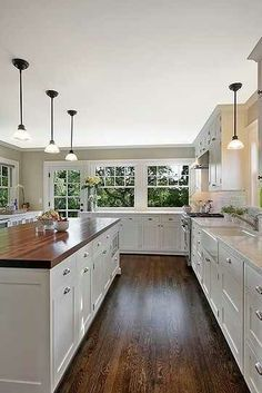 Love the wood in this kitchen and the space!!!