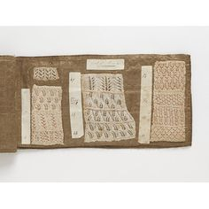 This book consists of knitting samples and handwritten notes by a knitter called Elizabeth Hume. Her pieces of work are attached to 12 glazed-cotton pages. Most of the samples are of fine lace knitting, but there are some pieces of solid wool knitting, of undyed Shetland wool and of coloured knitting. The book also includes examples of cotton knitting threads and wool.  The notes refer to patterns in the Knitting, Netting and Crochet Book. This best-selling volume of patterns by Mrs Gaugain…