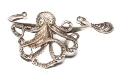 Octopus cuff with shell charm