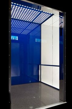 Ceiling: Steel sheet powder-coated in blue and LED backlight, Back Wall: Backpainted Glass