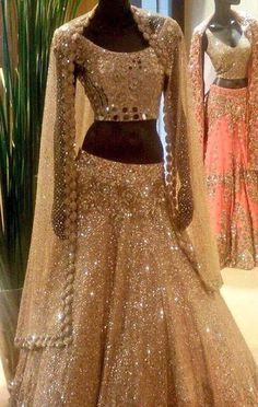 I am really falling in love with mirror work on lenghas and saris this year. Mirror work or shisha (glass) originates from century India when the Rajas and Ranis used to embellish their wardro… Indian Bridal Wear, Indian Wedding Outfits, Pakistani Outfits, Bridal Outfits, Indian Outfits, Bridal Dresses, Bridal Sari, Wedding Dress, Manish Malhotra Bridal