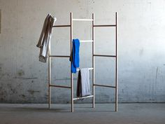 Minimalist clothes rack by Danish designer Jakob Jørgensen. The basic idea in Knock down-Cloth Rack is a simple wedge assembly, that can attach a horizontal element to a vertical load-bearing element.