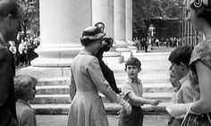 Prince Charles introduces his mother to his teachers on sports day at Hill House school, west London, in this home movie still from 1957. Photograph: Reuters