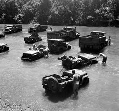 Washing jeeps and trucks on a South Pacific island, exact location unknown. Army Vehicles, Armored Vehicles, Willys Mb, Military Photos, Military Pins, Ww2 Photos, Cool Jeeps, War Image, Jeep Life