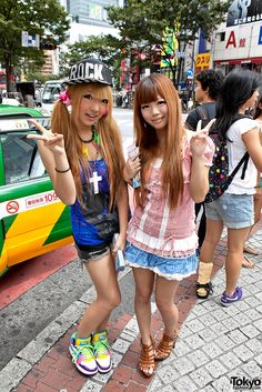 https://flic.kr/p/a7JGwh | Blonde Shibuya Gals | Two fun Japanese girls on the street near Shibuya 109 during the summer of 2011.