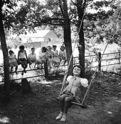 """""""Summer afternoon, summer afternoon; to me those have always been the two most beautiful words in the English language."""" ~ Henry James // Photo: Swing In Raizeux, France,1950, Robert Doisneau"""
