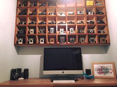 An Old Camera Collection Used To Decorate A Photographer's Office