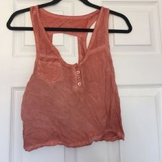 brandy Melville burnt orange tank used in great condition! has no tag but I promise it is brandy :) Brandy Melville Tops Tank Tops