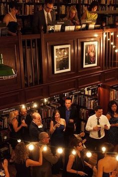 Reception location love: Housing Works Bookstore Cafe in NYC. Photography by getstak.com, Planning by emilyevents.com, Floral Design by cityiris.net