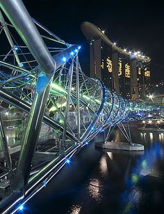 The Helix Bridge , previously known as the Double Helix Bridge , is a pedestrian bridge leading to the Marina Bay Sands Resort Casino and linking Marina Centre with Marina South in the Marina Bay area in Singapore. It is located beside the Benjamin Sheares Bridge and is accompanied by a vehicular bridge, known as the Bayfront Bridge.