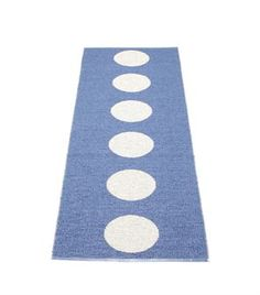 Vera is a jacquard woven soft plastic rug with a pattern of big dots in a straight line.Suitable for almost every household environment, inside as well as outside.