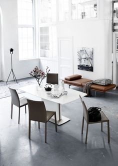 A muted and almost monotone palette with pops of fluoro or grounded with black. Rustic and deca...