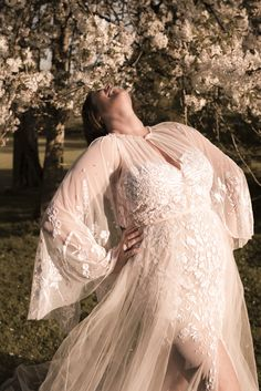 Lisa in our gorgeous soft pink Wildflower cape gown. #hermionedepaula #lisamcallister #motherdaughter #curvybride #capeweddingdress #pinkweddingdress #whimsical Hermione, Cape Gown, Curvy Bride, Veil, Wild Flowers, Whimsical, Lisa, Gowns, Mood