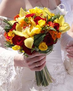 red,+hot+pink+and+yellow+flower+arrangements   bright summer bouquet of yellow cymbidium orchids, red roses, orange ...