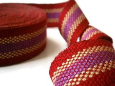 GEOMETRIC RED RIBBON WOVEN CRAFT SUPPLIES PERUVIAN FABRIC 2.7 m/2.9 yd Peruvian geometric design jacquard woven ribbon, fabric like texture, great for decorating bags, shoes, headbands and any other craft ideas you can think of. You will receive the exact lot shown on the picture. Please check out the pictures. Made in Peru. The piece has 2.7 m (2.9 yd) x 35 mm wide (1.37) approx. Main color: RED Hand wash cycle - cold water - polyester. Ribbon may be ironed on a low heat setting. Note: ...