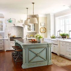 Love the white cabinet and the splash of color with the custom island.