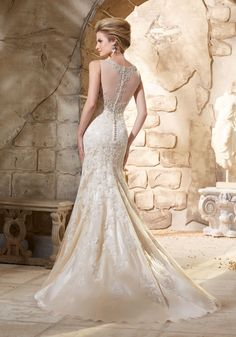 Beading and an illusion neckline and back, give this fitted Bridal Dress a rich, luxe look. Colors available: White/Silver, Ivory/Silver and Light Gold/Silver.