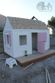 How to build an outdoor playhouse. Learn how to build a farmhouse style playhouse for your kids! kids playhouse DIY Farmhouse Style Outdoor Kids Playhouse (My Biggest Project Ever! Outside Playhouse, Girls Playhouse, Playhouse Kits, Backyard Playhouse, Build A Playhouse, Wooden Playhouse, Diy Door, Outdoor Play, Building Plans