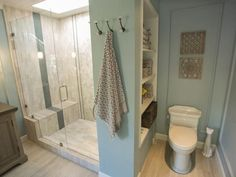 25 Amazing Room Makeovers from HGTV's House Hunters Renovation : Decorating : Home & Garden Television.those 3 hooks to add to my master bathroom wall for towels. Bathroom Renovations, Home Renovation, Home Remodeling, Bathroom Makeovers, Hgtv House Hunters, Ideas Baños, Decor Ideas, Decorating Ideas, Storage Design