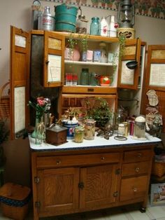 Hoosier Cabinet.  This looks alot like mine (mine is white crackle painted with green glass inserts.)