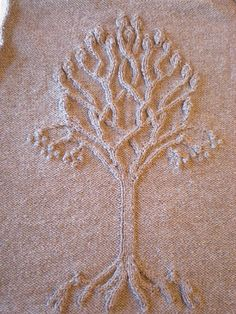 A knit tree pattern based on Arwen's shield from Lord of the Rings.