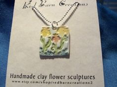 Stamped and painted cold porcelain pendant