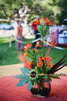 centerpiece with alstromeria, dyed wheat sunflower centers, aralia and pheasant feathers Sunflower Centerpieces, Centerpiece Ideas, Table Decorations, Work Inspiration, Wedding Designs, Floral Arrangements, Floral Design, Pheasant Feathers, Creative