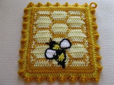 Handmade, honeycomb potholders with honey bees or bumble bees. This is an original crochet design with a hexagon pattern crocheted in light yellow and gold. The bees are crocheted in lemon yellow and black, with white wings. The outline of the bees are hand embroidered with black yarn. The potholders are double thick and the back panel is loom knit (double thick) with gold. Pot holders are bordered with lemon yellow and finished with a gold crochet ruffle.  This pot holder set is made to…