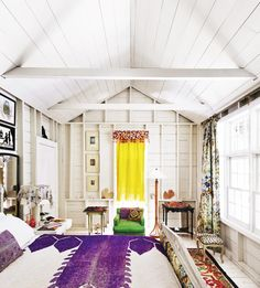 White bedroom with Moroccan-inspired textiles and colors