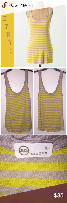 """NWOT Anthropologie striped Scoopback tank by AG Never worn! Only flaw is the tag was detached on one side (see pic 4). Make me an offer! DETAILS As summery as lemonade, as welcoming as a warm breeze, this drapey jersey tank epitomizes the ease of the season. By AG Rayon, polyester  25.75""""L  Imported   Style No. 25019985 Anthropologie Tops Tank Tops"""