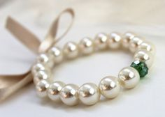 For bridesmaids. different color other than green -Beige ribboned pearl bracelet with green by asteriasbridal on Etsy, $9.50