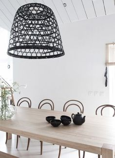 turn a wicker basket upside down to make a unique light fixture AND live the table