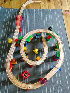 """My 2.5 year old toddler and I use Lego Duplos to build """"mountains"""" with the wooden train tracks."""