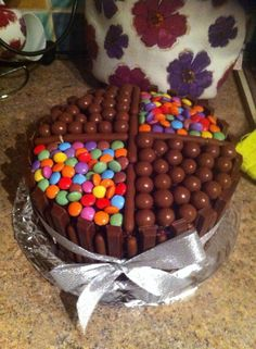 Chocolate cake with maltesers, kitkats, smarties and chocolate fingers