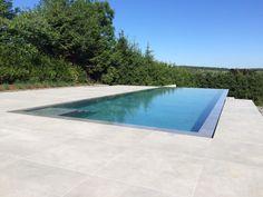 Piscine miroir - Le saviez-vous ? Une piscine miroir est une piscine à débordement en chacun de ses côtés.