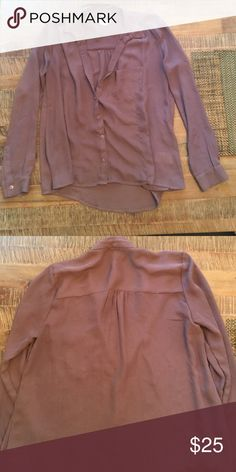 Urban outfitters button down blouse Purple button down long sleeve blouse. Great condition.  100% polyester Urban Outfitters Tops Button Down Shirts