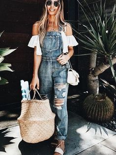Distressed denim overalls with white off the shoulder top.