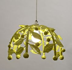 make this a DIY project with spray paint, wire leaf basket and lamp/light kit.