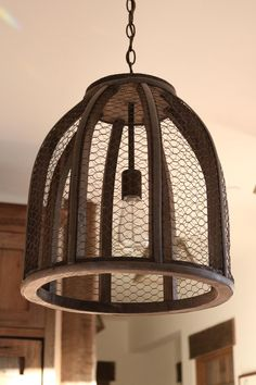 Chicken wire light fixtures provide farmhouse whimsy. This rustic lighting is from Shades of Light.