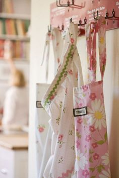 Aprons from old sheets - having a special apron to cook in makes cooking more fun, its a fact. This is a good sewing project for those just starting out, and an awesome way to reuse! (Retro tablecloths can also make great material for aprons too.)
