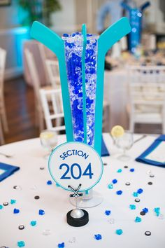 Hockey themed Wedding. Hockey Sticks. Centerpiece. Carly Fuller Photography