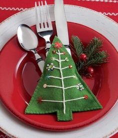 """TAG Christmas Tree Flatware Holder by Tag. $9.95. Blanket stitch detail. Hand sewn w/cotton thread and decorated with sequins and beads. Hand cut and hand appliqué wool felt holder. 6.125""""l x 5.875""""w [15.6cm l x 14.9w].. Dry clean only. Hand cut and hand appliqué wool felt holder. hand sewn w/cotton thread and decorated w/sequins and beads. blanket stitch detail. dry clean only."""