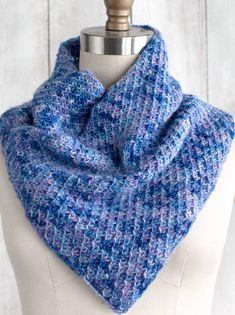 Free Knitting Pattern for 4 Row Repeat Racimo Cowl - This shoulder cozy features a 4 row repeat Quilted Cross Stitch. Fingering yarn. Designed by Sarah Solomon. Perfect for multi-colored yarn.