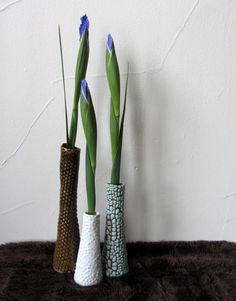 Bud vases made of a variety of clay bodies