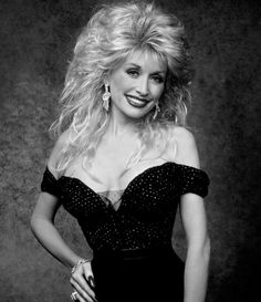 Dolly Parton, with her factory set of breasts, which look normal and amazing. Not sure why she thinks she had to get them sooooo big, then decided to reduce the size but get natural smaller set are much better