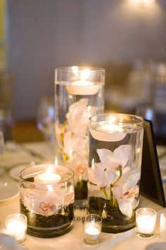 Low centerpiece idea that allows guests to have conversation without flowers in their face. Candles add to the atmosphere of the reception.