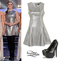 Demi Lovato shined on the stage of X-Factor last night. She wore a Topshop Metallic Seam Shift Dress ($110.00) with the Black 120 Denier Opaque Tights ($16.00) and her favourite Supreme Mega High Platforms ($176.00).